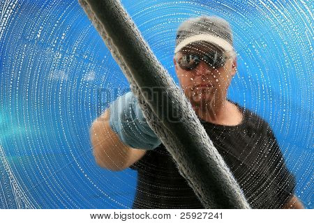 a professional window cleaner soaps and squeegies a window clean