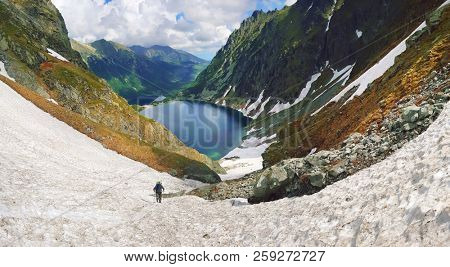 Morskie Oko. High Tatras, Poland, May 27, 2018. Beautiful landscape of snowy mountain tops and the lake between them. View from the mountain Rysy.
