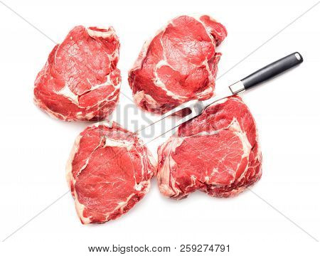 Set Of Raw Beef Steaks Isolated On White Background