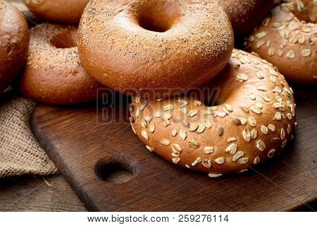Heap Of Fresh Baked Bagels On Wooden Background