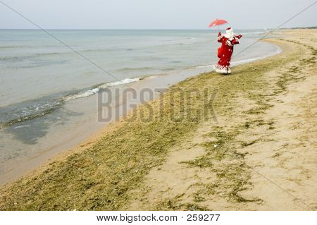 Santa Claus On The Seaside