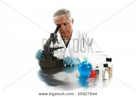 a medical research scientist or chemist works on a cure for something to help mankind. isolated on white with room for your text. .