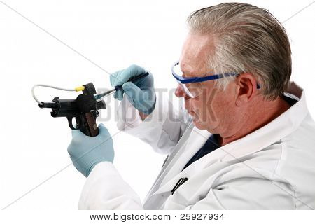 forensic analysis - a forensics lab technician examines a hand gun for finger prints, blood splatter, and any other residue or evidence to be used in a court case