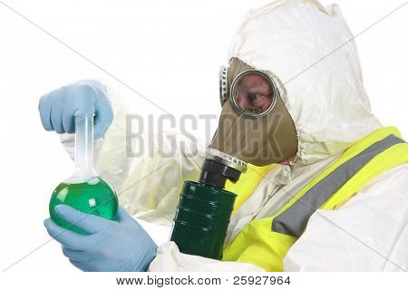 terrorist, nuclear, chemical - a man in a hazmat suit, gas mask, and gloves and vest examines a dangerous chemical bomb he has manufactured in his laboratory. isolated on white with room for your text