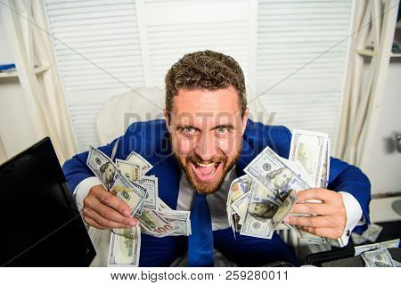 Profit And Richness Concept. Businessman Formal Suit Hold Cash Dollars Hands. Che K Out My Profit Th
