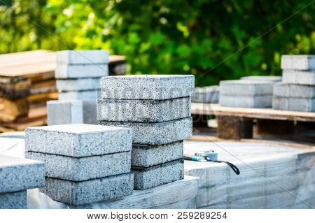 Stack Of Concrete Paving Slabs Tiles Ready For Laying Pavement.