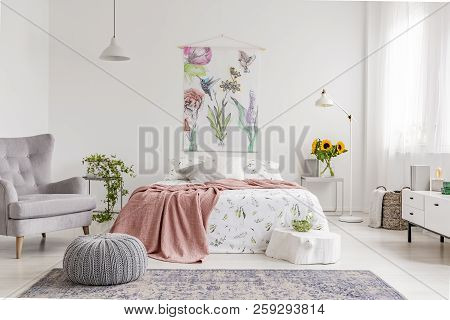 Nature Lover's Bright Bedroom Interior With A Wall Art Of Flowers And Birds Painted On A Fabric Abov