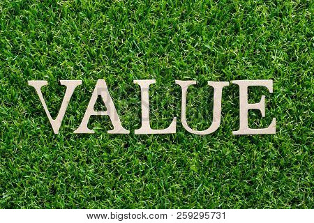 Wood Letter In Word Value On Artificial Green Grass Background