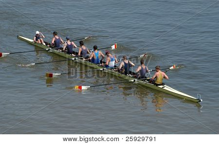 Junior rowing team rowing during a boat-race on the River Vltava in Prague, Czech Republic