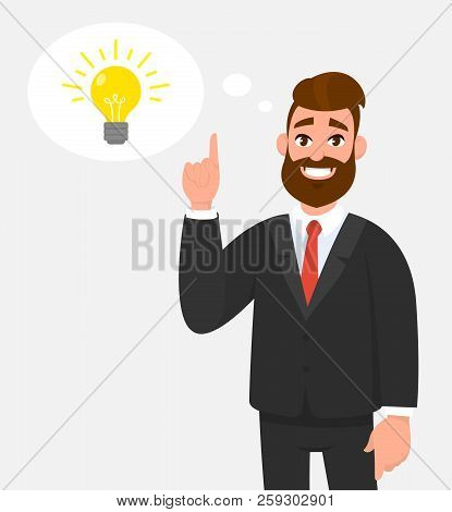 Thoughtful Happy Businessman Pointing Up To The Bright Bulb In The Thought Bubble. Idea, Innovation,