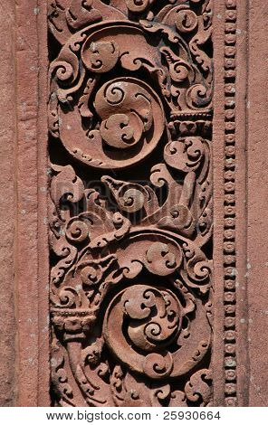 Red stone carving of the Banteay Srei Temple in the Angkor Area near Siem Reap, Cambodia.