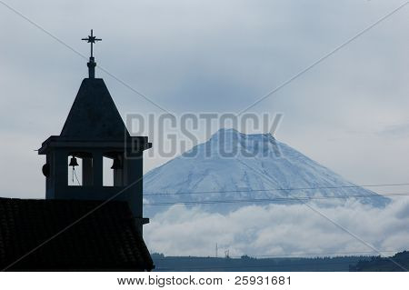 Silhouette of a bell tower with Cotopaxi Volcano (5897 m) in the background in the Andes, Ecuador