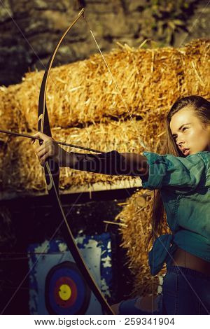 Confident, Cute Woman Or Adorable Girl, Archer Or Hunter, Shooting With Bow And Arrow On Sunny Day A