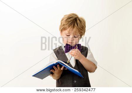 Preschool Kid Writing In Notebook With Pen. Clever Boy. Little Boy Writes In Notebook. Education, Le