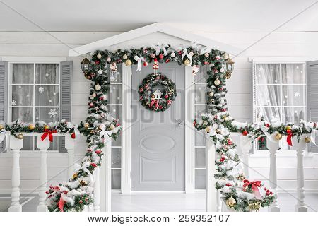 Christmas Morning. Porch A Small House With A Decorated Door With A Christmas Wreath. Winter Fairy T