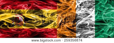 Spain Vs Ivory Coast Smoke Flags Placed Side By Side. Thick Colored Silky Smoke Flags Of Spanish And