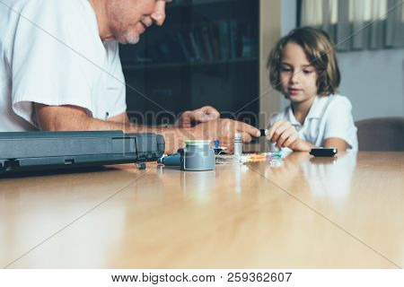 Diabetic Equipments On A Doctor Desk And A Diabetic Child And An Endocrine At The Background. Child