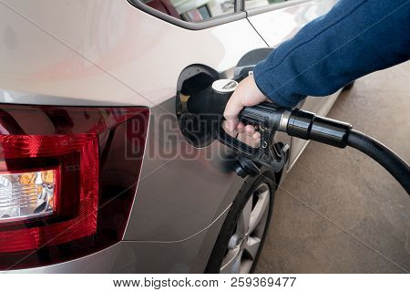 Closeup Of Man Pumping Diesel Fuel For Diesel Engines In Car At Gas Station.
