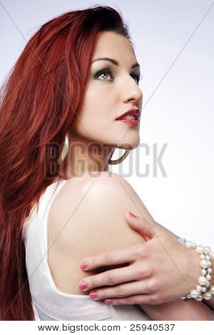Portrait of young beautiful redhead woman.