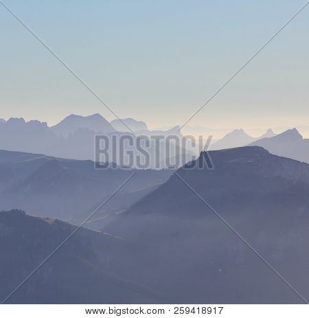 Silhouettes Of Mountains In The Bernese Oberland, Switzerland.