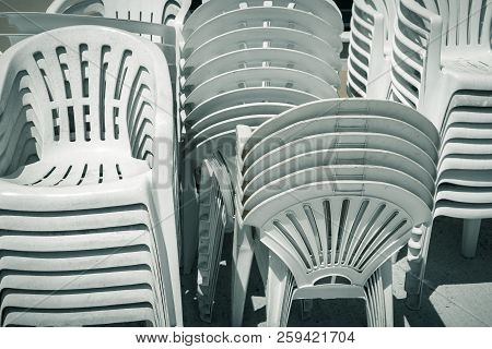 White Dirty Old Stacks Of Plastic Chairs
