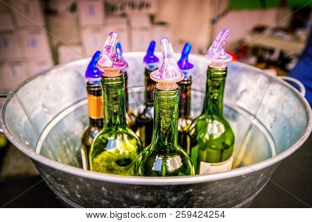 Wine Bottles Stored In A Cooled Bucket And Ready At A Wine Tasting.