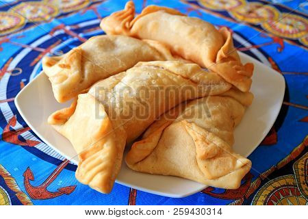 Many Of Chilean Empanadas Or Savory Stuffed Pastries Served On White Plate, Easter Island, Chile