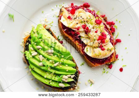 Healthy Sandwich On Sweet Potato For Breakfast Or Snack. One Toasts With Avocado And Other With Rasp