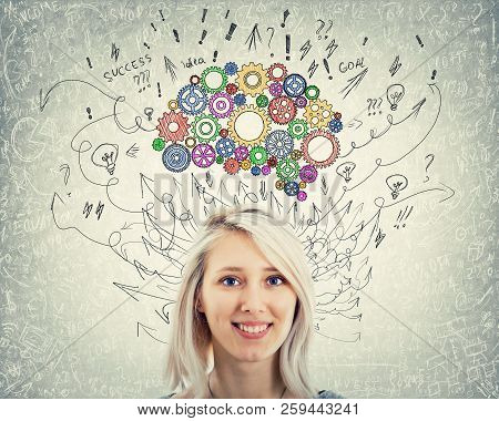 Close Up Portrait Of A Young Woman With Colorful Gear Brain Above Head. Happy Emotion, Positive Thin