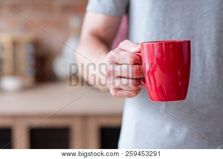 Traditional Morning Hot Energizing Drink. Quick And Easy Breakfast. Man Holding Tea Or Instant Coffe
