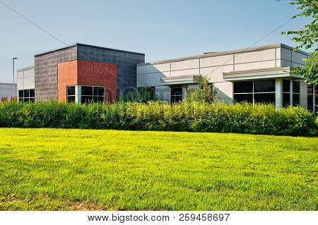 Unoccupied Generic Backside Of Store, Business Or Professional Office Space.