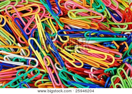 Colorful heap of paper clips - good office background