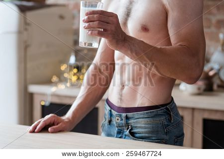 Sport Drink And Fitness Concept. Sexy Fit Muscled Bare Chested Unrecognizable Man With Sixpack Holdi