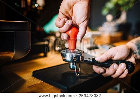 Professional Barista Using Tamper And Pouring Freshly Brewed Coffee In Cafe Shop. Barista Details An