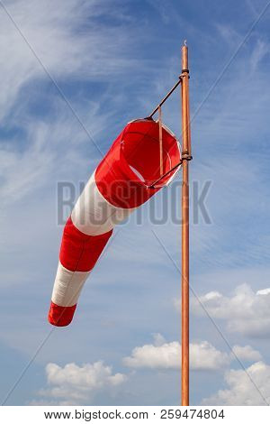 Wind Sock, Air Field Direction And Wind Speed Sign And A Wind Force With The Yard And Garden Backgro