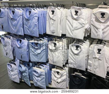 Shirt shelfs, fashion colored shirts on shop