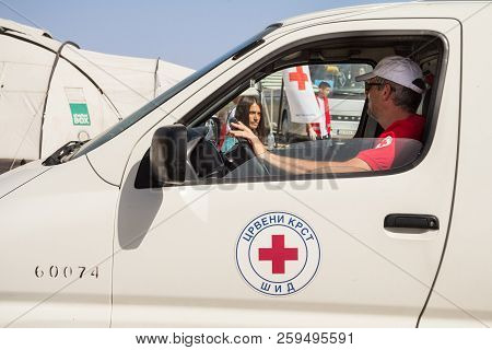 Sid, Serbia - September 19, 2015: Worker Of The Red Cross Of Serbia (crveni Krst Srbije) Driving A T
