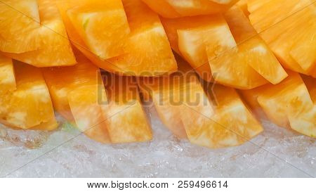 Orange Or Yellow Pineapple Sliced On Crushed Ice. Tropical Fruit. Healthy Snack. Bromelain Enzyme Ex