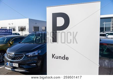 Fuerth / Germany - February 25, 2018: Parking Area Sign Near A Volkswagen Car Dealer. Kunde Means Cu