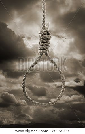 Sepia toned photograph of a hangman's Noose against cloudy sky.