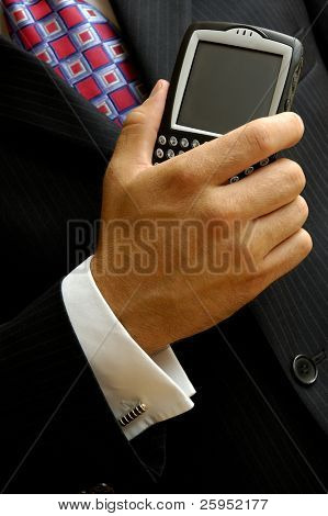 Businessman With A Mobile Handheld Computer