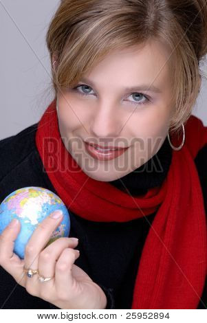 Pretty Young Woman Holding The World In Her Hand. (Focus On Her Face, Shallow DOF, Globe & Hand Out Of Focus)
