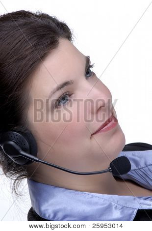 Young Woman Wearing A Telephone Headset And Business Wear