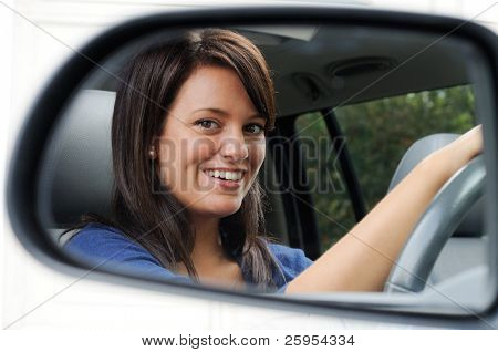 Woman Driver Framed By Her Driving Mirror