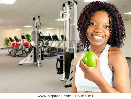 African American Young Woman Enjoying A Healthy Snack At The Gym