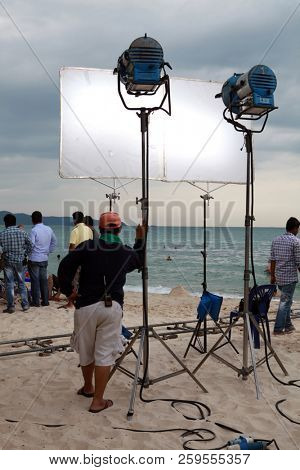 PATTAYA, THAILAND - DECEMBER 22: Team of professionals shoots film on the coast on December 22, 2013 in Pattaya.