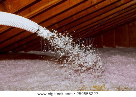 Spraying Blown Fiberglass Insulation For Roof Technician Spraying Foam Insulation Using Plural Compo