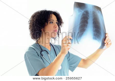 Female Nurse Looking At A Patients Chest X-Ray Wearing Hospital Scrubs