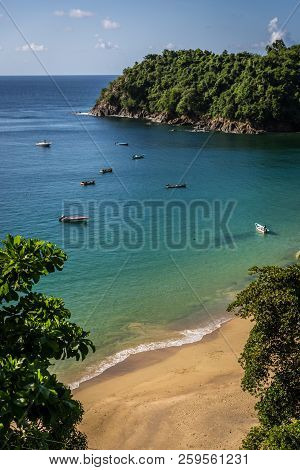 Amazing Tropical Beach In Trinidad And Tobago, Caribe - Blue Sky, Trees, Sand Beach, Wood Boats