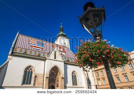 Church of St. Mark and flowers jardiniere, Zagreb, Croatia, Europe. Upper town, Gornji Grad, historical part of old Zagreb poster